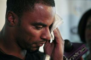 Darren Sharper wipes his face during a news conference to announce a charity softball game, in Metairie, La., Wednesday, June 1, 2011.
