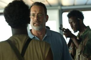 This film image released by Sony - Columbia Pictures shows Tom Hanks, center, in a scene from Captain Phillips.