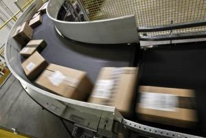 Ready-to-ship items move along a conveyor belt at an Amazon warehouse.