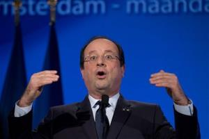 French President Francois Hollande raises his hands during a speech at the National Maritime Museum in Amsterdam, Netherlands, Monday, Jan. 20, 2014.