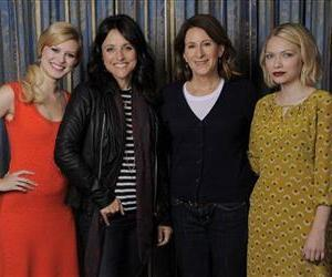 Writer-director Nicole Holofcener, second right,  of the film Enough Said, poses with cast members, from left, Tracey Fairaway, Julia Louis-Dreyfus and Tavi Gevinson on Sept. 8, 2013 in Toronto.