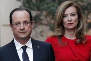 In this Tuesday, May. 7, 2013, file photo, French President Francois Hollande, left, and his companion Valerie Trierweiler arrive for a state dinner at the Elysee Palace in Paris.