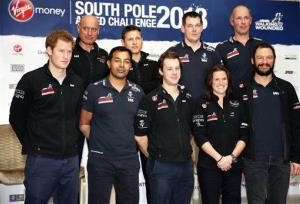 Britain's Prince Harry, left, the Expedition Patron, poses with members of the Walking With The Wounded South Pole Allied Challenge 2013 team in central  London, Tuesday, Jan. 21, 2014.