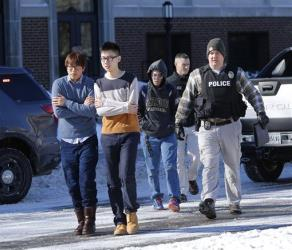 Police evacuate students from the electrical engineering building after shots were fired.