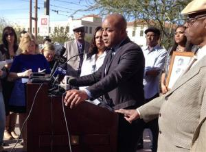The Rev. Jarrett Maupin, center, an Arizona civil rights activist, speaks during a news conference in Phoenix, Tuesday, Jan. 21, 2014, after the party.