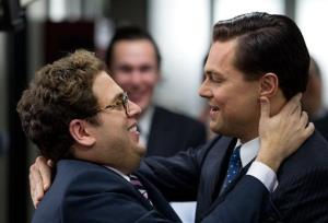 This film image released by Paramount Pictures shows  Jonah Hill, left, and Leonardo DiCaprio in a scene from The Wolf of Wall Street.