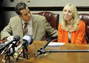 Nicole Oulson, the widow of Chad Oulson who was shot and killed over a texting dispute, is consoled by attorney TJ Grimaldi Wednesday, Jan. 22, 2014.