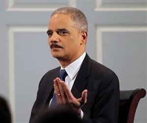 Attorney General Eric Holder speaks during an interview with Douglas Blackmon on Thursday, Jan. 23, 2014, at the Miller Center at the University of Virginia in Charlottesville.