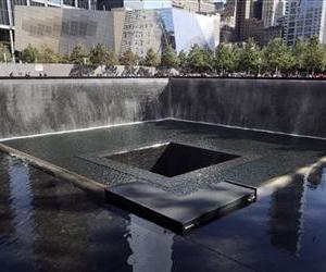 In this Sept. 6, 2013, file photo, the National September 11 Museum is seen beyond the North Pool at the memorial in New York.