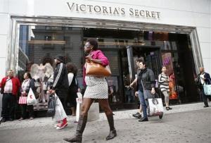 Pedestrians pass by a Victoria's Secret store.