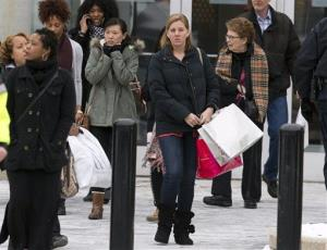 Shoppers are evacuated by police and rescue personnel after a shooting at the Mall in Columbia on Saturday, Jan. 25, 2014, in Columbia, Md.