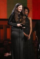 Lorde accepts the award for best pop solo performance for Royals at the 56th annual Grammy Awards at Staples Center on Sunday, Jan. 26, 2014, in Los Angeles.