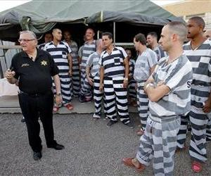 Inmates gather next to Maricopa County Sheriff Joe Arpaio as he walks through a Maricopa County Sheriff's Office jail  in Phoenix.