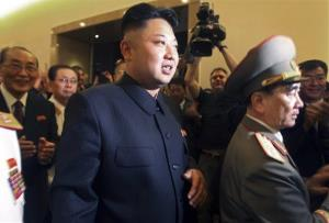 In this July 27, 2013 file photo, North Korean leader Kim Jong Un, center, is followed by his uncle Jang Song Thaek, second from left.