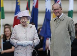 Britain's Queen Elizabeth II, left, accompanied by Prince Philip, the Duke of Edinburgh, are shown at Buckingham Palace in London, Wednesday, Oct. 9, 2013.