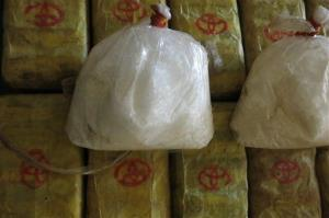 In this Feb. 15, 2013 photo, two bags of crystal meth and packets of methamphetamine pills.