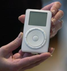 The original iPod is displayed after its introduction by Steve Jobs during a news conference in Cupertino, Calif. in this Oct. 23, 2001 file photo.