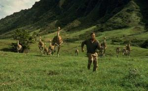 In this 1993 file image originally released by Universal Pictures, Sam Neill, portraying Dr. Alan Grant, runs from dinosaurs in a scene from Jurassic Park.