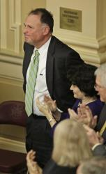 State Sen. Creigh Deeds stands to acknowledge the applause of the assembly as he was welcomed back by Virginia Gov. Bob McDonnell at the Capitol in Richmond, Va., Wednesday, Jan. 8, 2014.