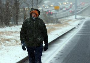 Dedicated employee David Gress, 47, walks along Peachtree Industrial Boulevard making a 6-mile trip on foot to work from his home in Dunwoody on Tuesday, Jan. 28, 2014, in Doraville, Georgia.