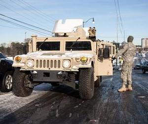 National Guard Pfc. Josh Krunnker prepares to tow a car on Ashford Dunwoody near Interstate 285, Jan. 29, 2014 in Dunwoody, Ga.