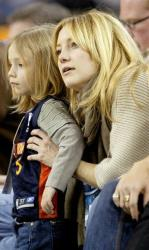 Kate Hudson with son Ryder, then 4, watches as the Golden State Warriors play the Minnesota Timberwolves on Monday, Jan. 21, 2008, in Oakland, Calif.