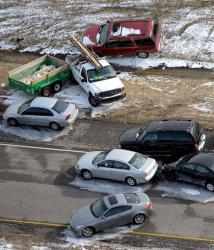 Abandoned cars and trucks litter the road after a winter snow storm on Wednesday, Jan. 29, 2014, near Birmingham, Ala.