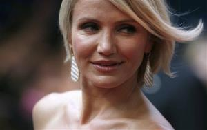 Cameron Diaz poses for photographers as she arrives for the European premiere of the movie 'What to Expect When You're Expecting' at a cinema in London, Tuesday, May 22, 2012.