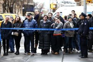 People look toward the home of Philip Seymour Hoffman, Sunday, Feb. 2, 2014, in New York.