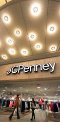 Two people are pictured walk near the entrance of the JCPenney store in the Wausau Center mall in Wausau, Wis.