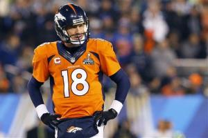 Denver Broncos' Peyton Manning pauses during the second half of the NFL Super Bowl XLVIII football game against the Denver Broncos Sunday, Feb. 2, 2014, in East Rutherford, N.J.