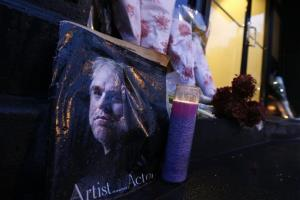 A makeshift memorial sits outside the home of actor Philip Seymour Hoffman, Monday, Feb. 3, 2014, in New York.