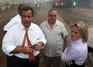 In this Sept. 12, 2013 photo, then-Deputy Chief of Staff Bridget Anne Kelly, right, stands with Chris Christie, left, during a tour of the Seaside Heights, NJ, boardwalk after a fire.