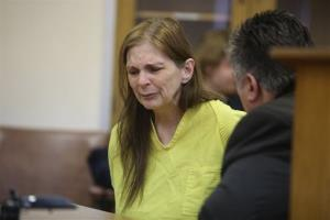 Donna Kay Scrivo appears for arraignment before being charged with the disinterment of her son Ramsay Scivo , on Monday Feb, 3, 2014, at 40th District Court in St. Clair Shores, Mich.