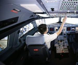 A pilot is seen in an airline cockpit in this file photo.
