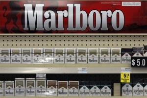 In this Wednesday, July 17, 2013, photo, Marlboro cigarettes are on display in a CVS store in Pittsburgh.