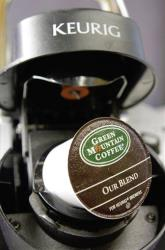 A Green Mountain Coffee single-serving brewing cup is seen in a Keurig machine in Montpelier, Vt.