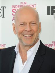 Actor Bruce Willis arrives at the Independent Spirit Awards on Saturday, Feb. 23, 2013, in Santa Monica, Calif.