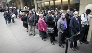 In this file photo, job seekers wait to enter a jobs' fair in New York City.