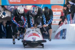 Nick Cunningham, Justin Olsen, Johnny Quinn and Dallas Robinson from the US in the four-man bobsled World Cup in St. Moritz, Switzerland, Sunday, Jan. 12, 2014.