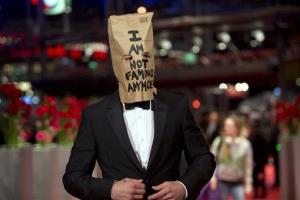 Actor Shia LaBeouf poses with a paper bag over his head that says I am not famous anymore, on the red carpet for the film Nymphomaniac in Berlin, Sunday, Feb. 9, 2014.