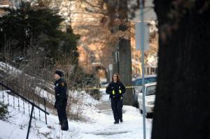 Police investigate the scene where the bodies of sisters Susan Wolfe and Sarah Wolfe were found in the basement of their home in Pittsburgh.