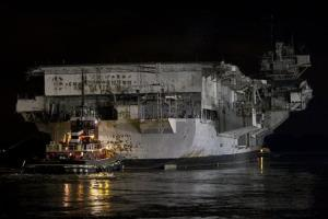 Tugboat Alex McAllister pushes the USS Forrestal into the Delaware River on the aircraft carrier's final voyage from Navy Shipyard in south Philadelphia, Tuesday, Feb. 4.