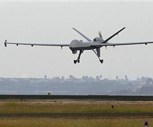 This Nov. 8, 2011 file photo shows a Predator B unmanned aircraft landing after a mission, at the Naval Air Station, in Corpus Christi, Texas.