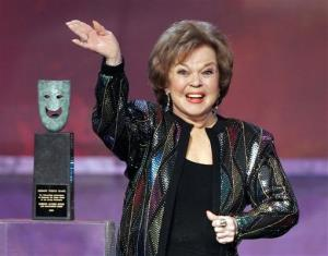 In this Jan. 29, 2006 file photo, Shirley Temple Black accepts the Screen Actors Guild Awards' life achievement award in Los Angeles.