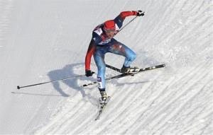 Russia's Anton Gafarov falls with a broken ski during his men's semifinal of the cross-country sprint at the 2014 Winter Olympics.