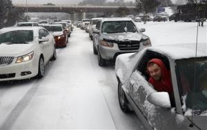 Kevin Miller looks out of the passenger window of his friend's car as they sit in stuck traffic during a storm Wednesday in Raleigh, N.C.