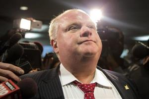 Toronto Mayor Rob Ford is questioned by reporters in Toronto.