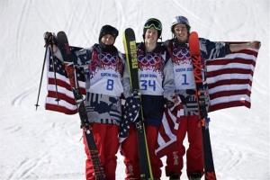 Men's ski slopestyle medalists from the United States Gus Kenworthy, left, silver, Joss Christensen, center, gold, and Nicholas Goepper, bronze, right.