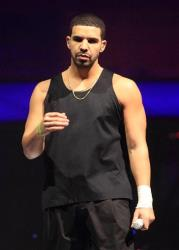Rapper Drake performs in concert on the last date of his Would You Like A Tour? 2013 at the Wells Fargo Center on Wednesday, Dec. 18, 2013, in Philadelphia.